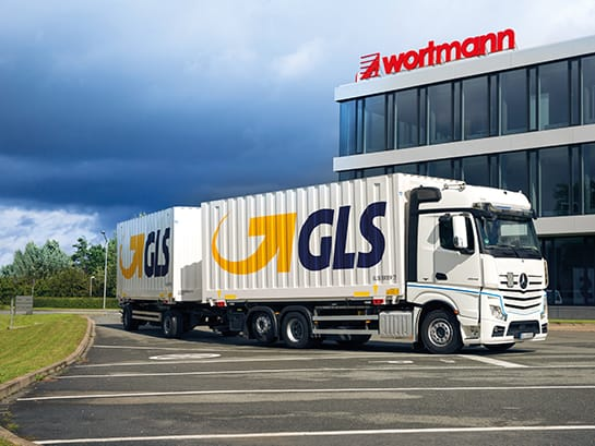 Well-known companies have been relying on GLS for years – a truck from GLS parcel service stands in front of a company building